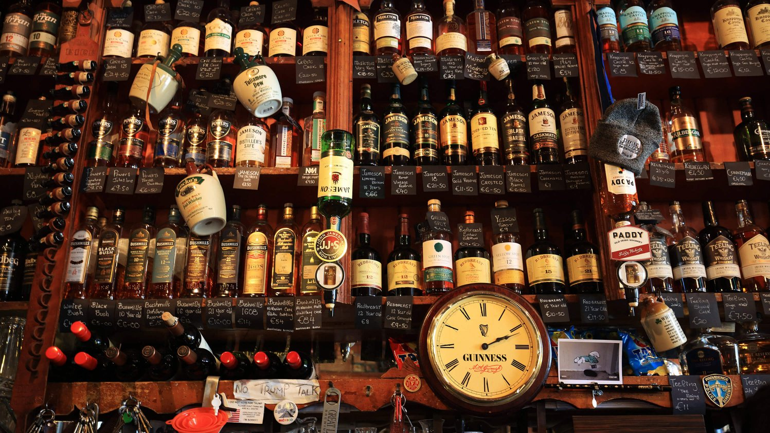 The extensive whiskey selection behind the bar at Dick Mack's in Dingle, Ireland