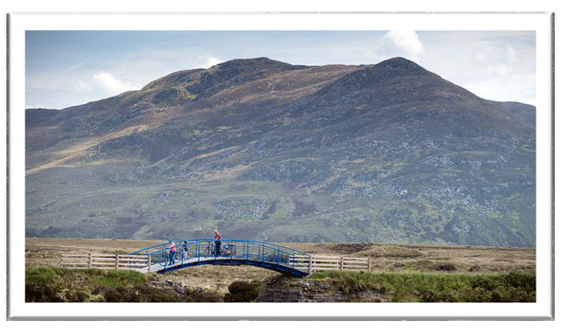 Cycling along the Greenway with the Nephin mountain range in the background