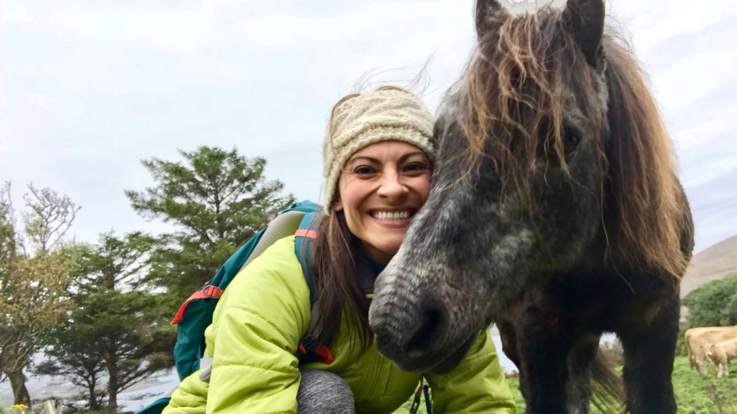 Vagabond guest poses for a selfie with a pony