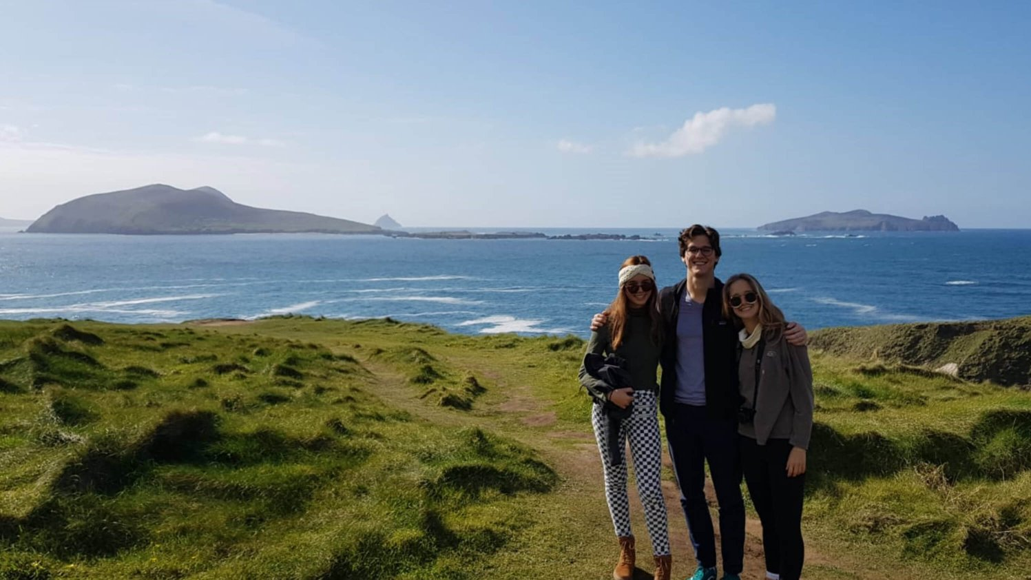 Vagabond guests pose with the Blasket Islands in the background