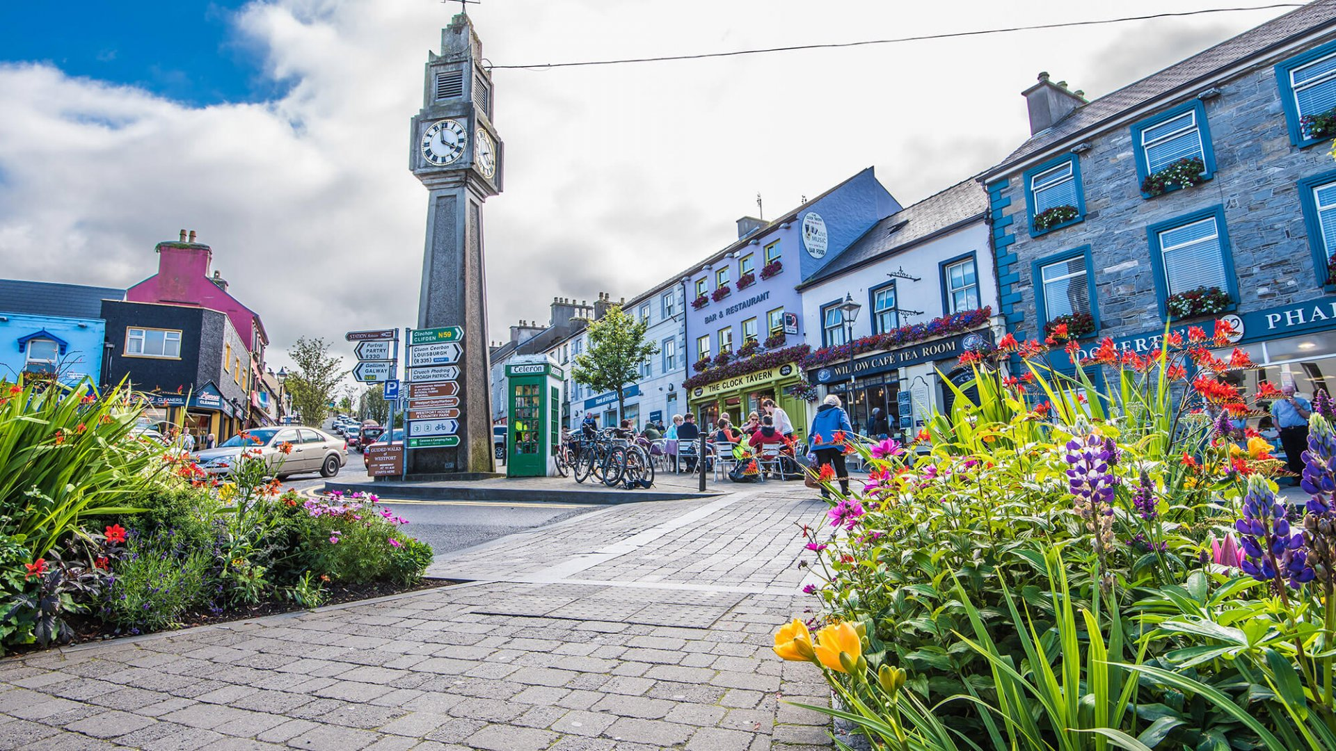 Clock tower and flowers in Westport town centre