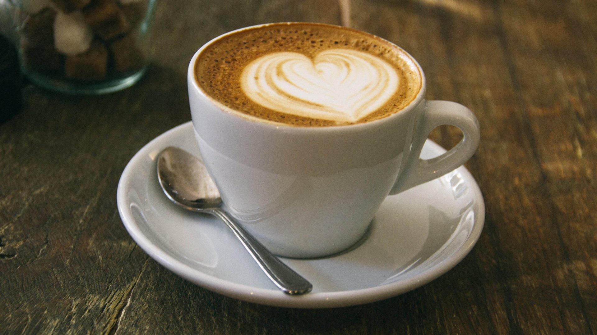 A heart shape in foamed milk on top of a barista coffee