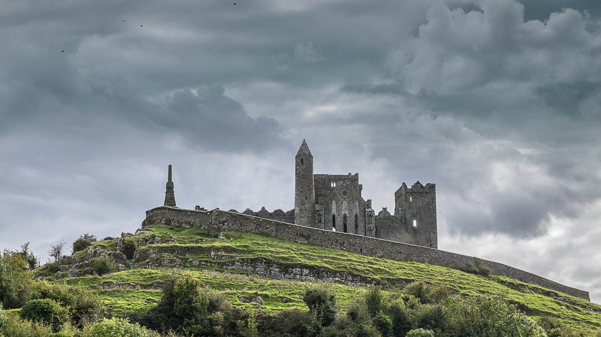 The monumental Rock of Cashel rises above the green Tipperary landscape